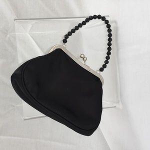 Black silky vintage evening bag.